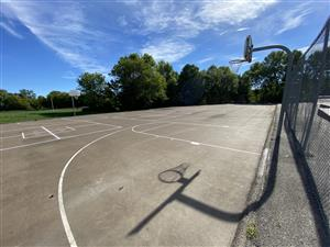 A view of the basketball courts on a sunny day